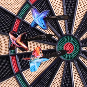 The WIN.MAX board's ultra-thin spider allows for tighter shot groupings and a larger surface area, increasing the ratio of landed shots and greatly reducing bounce-outs. A large missed dart catch ring offers protection for your wall from errant throws.